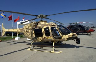 Bell Helicopter' static display was located near FIDAE 2014's flag poles area and featured the 407GT, the 429WLG and, in the rear, the 505 Jet Ranger X (photo: Fernando Puppio).